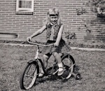 On my first bicycle, age four.  Watch out for Super-Environmentalist!