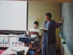 I teaching Latin, in schoolmarm garb.