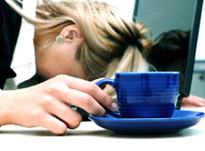 exhausted-woman with head down at desk