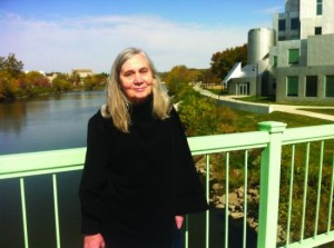Marilynne Robinson on a footbridge on the Iowa River