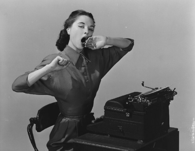 woman yawning at typewriter 1551_2
