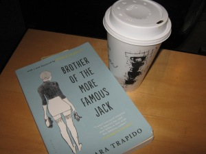 Photo of book and coffee drink.