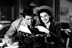 "Cary Grant and Rosalind Russell work together on a story in ""His Girl Friday."""