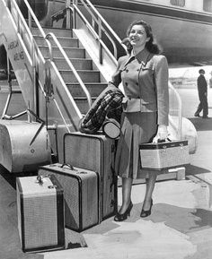 woman-with-suitcases-in-airport-0636a5184c1670f4514954228afaf8d5