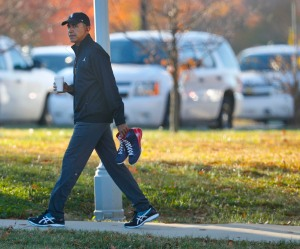 President Barack Obama carries a pair of sneakers as he arrives for a private game of basketball at Fort McNair in Washington, Tuesday, Nov. 8, 2016. Playing basketball on election day is a tradition for Obama. (AP Photo/Pablo Martinez Monsivais) ORG XMIT: DCPM107